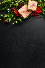 Noel or Christmas dark background with gift boxes