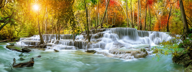 Fotobehang Watervallen Colorful majestic waterfall in national park forest during autumn, panorama - Image