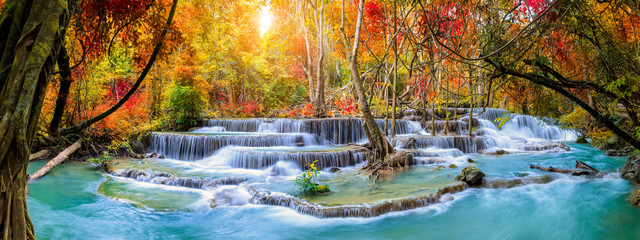Foto op Canvas Panoramafoto s Colorful majestic waterfall in national park forest during autumn, panorama - Image