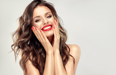 Papiers peints Salon de coiffure Beautiful laughing brunette model girl with long curly hair . Smiling woman hairstyle wavy curls . Red lips and nails manicure . Fashion , beauty and make up portrait