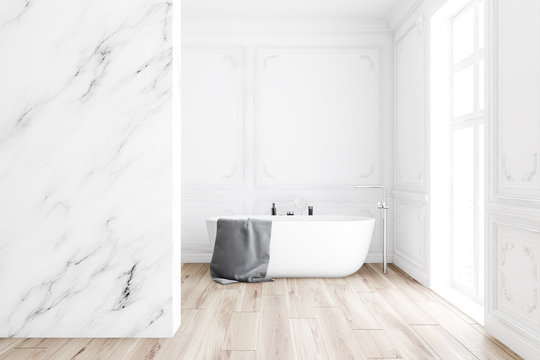 Luxury white marble bathroom interior with tub