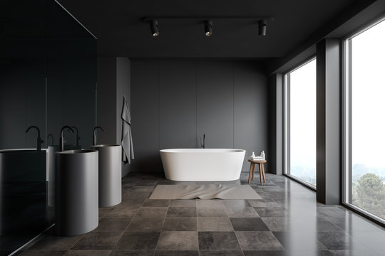 Gray comfortable bathroom with tiled floor