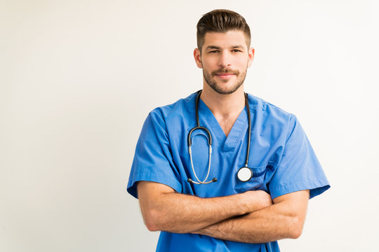 Portrait Of Young Surgeon Isolated Against Plain Background