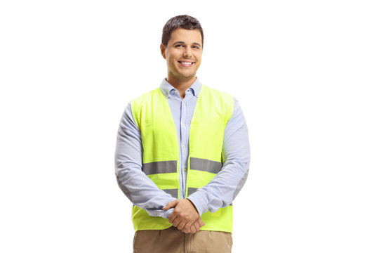 full length portrait of young man with arms crossed and safety vest