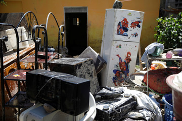 Furniture and appliances dry outside of a house in an area flooded by rains from last night in Port-au-Prince