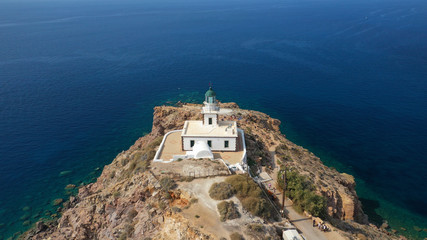 Aerial drone photo of iconic lighthouse of Akrotiri near Akrotiri village, Santorini island, Cyclades, Greece