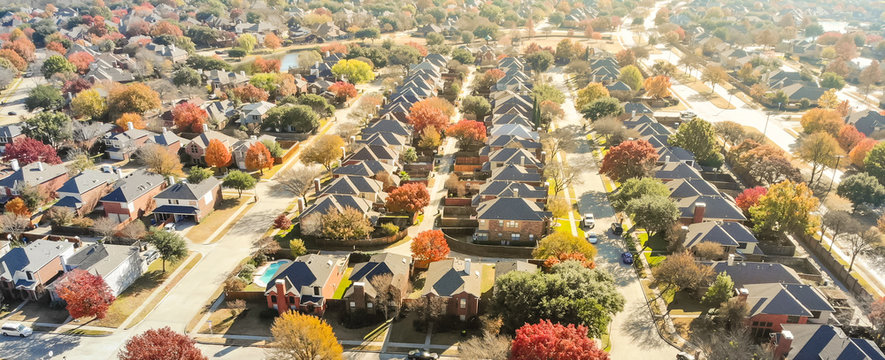 Aerial view row of new house with cul-de-sac (dead-end) and bright orange color fall foliage near Dallas
