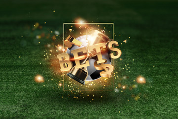 Golden Lettering Bets with soccer ball and green lawn background. Bets, sports betting, watch sports and bet.