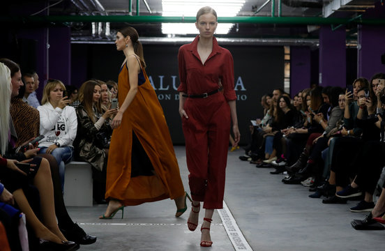 Models present creations by Balunova fashion design studio during a show at Belarus Fashion Week in Minsk