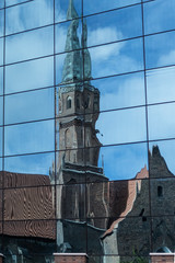 St. Dominicus church in Wroclaw being reflected in a glass facade