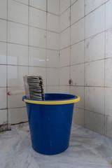 Paste brush on a plastic bucket