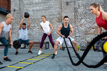 Group training, fitness group, working out together Wall mural
