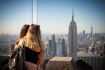 Young girls watching New York skyline