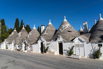 Trulli of Alberobello. View of Trulli houses .The traditional Trulli houses in Alberobello city, Puglia, Italy - April 30, 2019: Church in Trullo Parish Sant'Antonio of Padua - Immagine