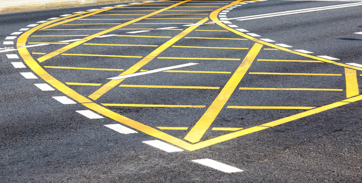 White and yellow road lines on the asphalt