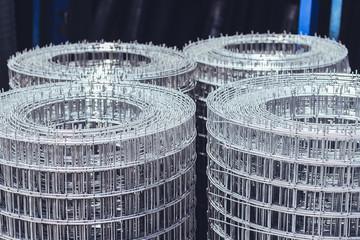 Welded mesh rolls in a hardware warehouse