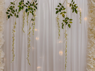 Floral decoration on white curtain