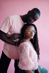 Portrait of young man and woman in pink