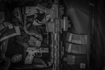 A closeup of a black gun in a case. Airsoft Gun.