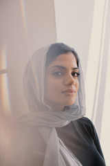 Thoughtful woman wearing blue hijab