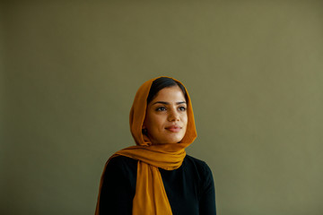 Portrait of young woman in a hijab