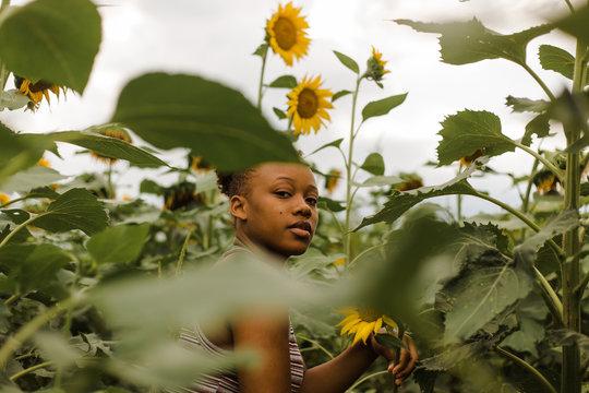 Portrait of woman in sunflower garden