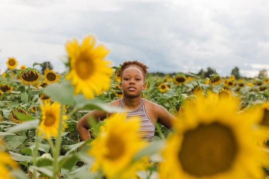 Portrait of woman standing in sunflower garden
