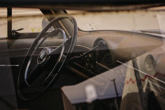 View of steering wheel through car window