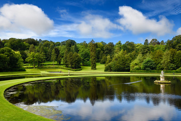 Studley Royal Water Garden Moon Pond with Neptune sculpture on the River Skell at Fountains Abbey