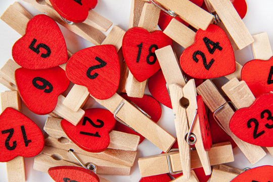 Advent calender numbers on red hearts. Christmas concept. Valentines day on white background.