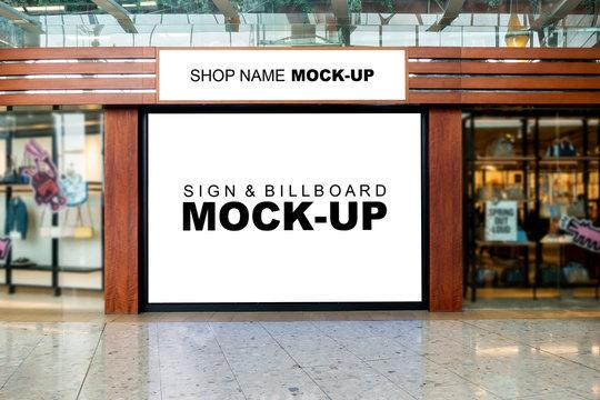 Mock up shop name and large billboard at airport terminal