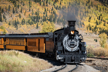 Vintage Steam Train With Autumn Scenery Background.