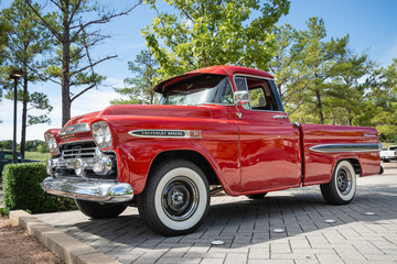 Front view of a red vintage Chevrolet Apache 31 Fleetside pickup truck classic car on October 20, 2018 in Westlake, Texas.