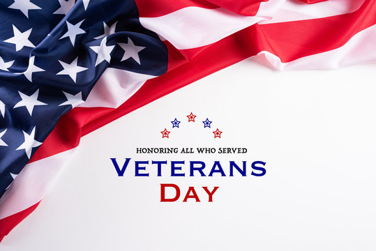 Happy Veterans Day. American flags with the text thank you veterans against a white background. November 11.