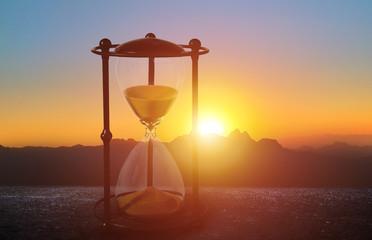 aesthetic hourglass in the beautiful setting sun Wall mural