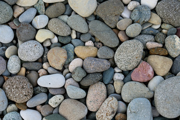 Round pebbles sea texture background