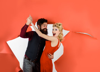 Happy couple enjoying dance. Cute young couple dancing. Stylish couple dancing. Dancing people in dance class. Romantic couple dance together at dance hall. Pretty woman and bearded man dancing.