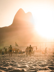 Ipanema Beach with Two Brothers in background - Rio de Janeiro at sunset