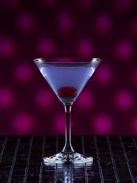 Aviation cocktail on pink dotted background