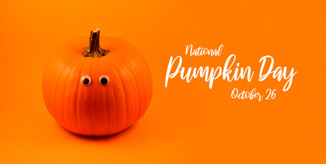 National Pumpkin Day images. Halloween pumpkin with eyes on a orange background. Single cute halloween pumpkin on a orange background. Important day