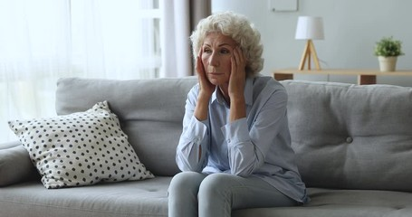 Fotomurales - Stressed worried older woman concerned about health problems at home