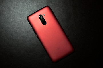 Acrylic Prints F1 Top view of Xiaomi Pocophone red rose color on black background