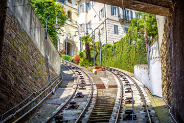Fototapete - View to Citta Alta houses from tunnel of funicular, Bergamo, Italy. Funicular San Vigilio connects old Upper City and new. Scenery of rail road in the Bergamo historical center in summer.