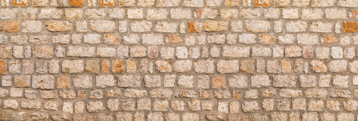 Fotobehang - Texture of unshaped brown stone wall pattern, made of rocks