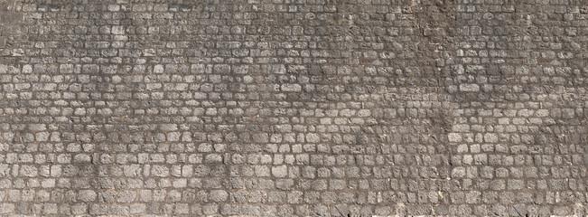 Fotobehang - Background of vintage brick stone wall panorama texture