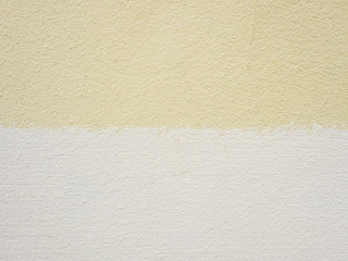 Yellow and beige painted cement wall. Abstract grunge texture background. Copy space, empty...
