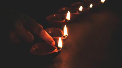 Diwali festival lamp on wooden background