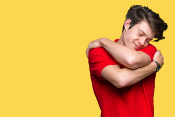 Young handsome man wearing red t-shirt over isolated background Hugging oneself happy and positive, smiling confident. Self love and self care