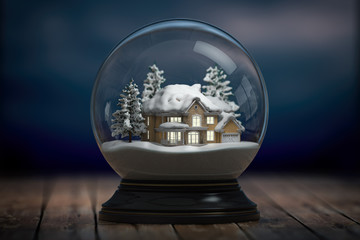 Glass snow globe and a house with lights in windows in the night.