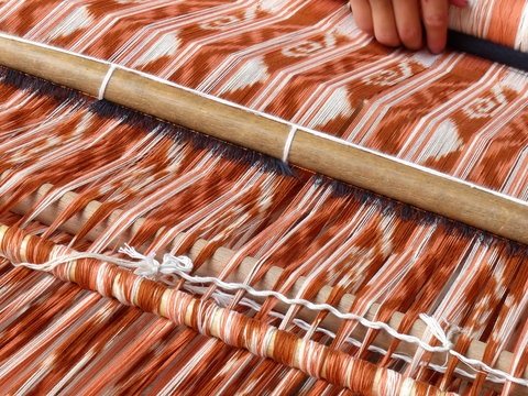Close up of traditional weaving technique IKAT for making scarfs or Macana or other fabric by hand with cotton threads, design are traditional for Gualaceo canton, Azuay province, Ecuador